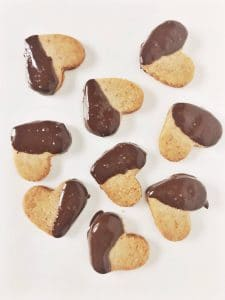 almond flour shortbread cookies in shape of hearts covered in chocolate