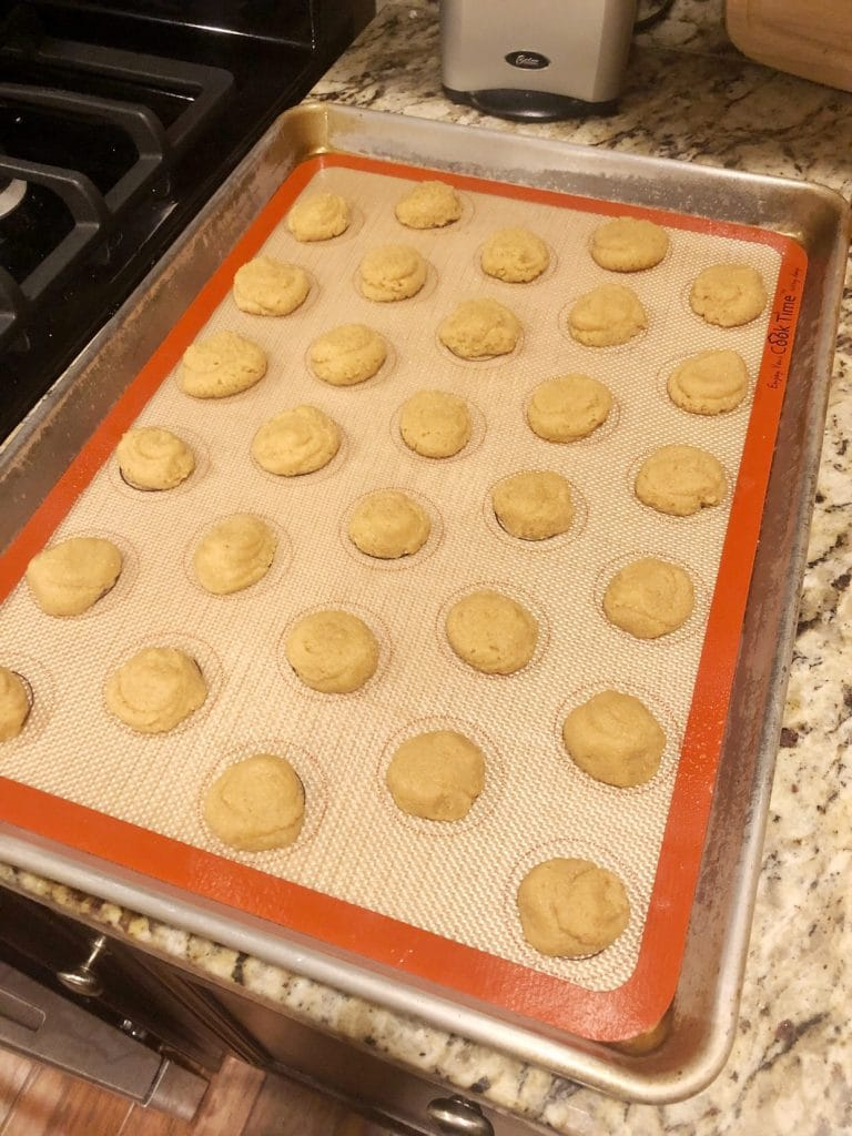 macarons on a baking sheet ready to go in the oven