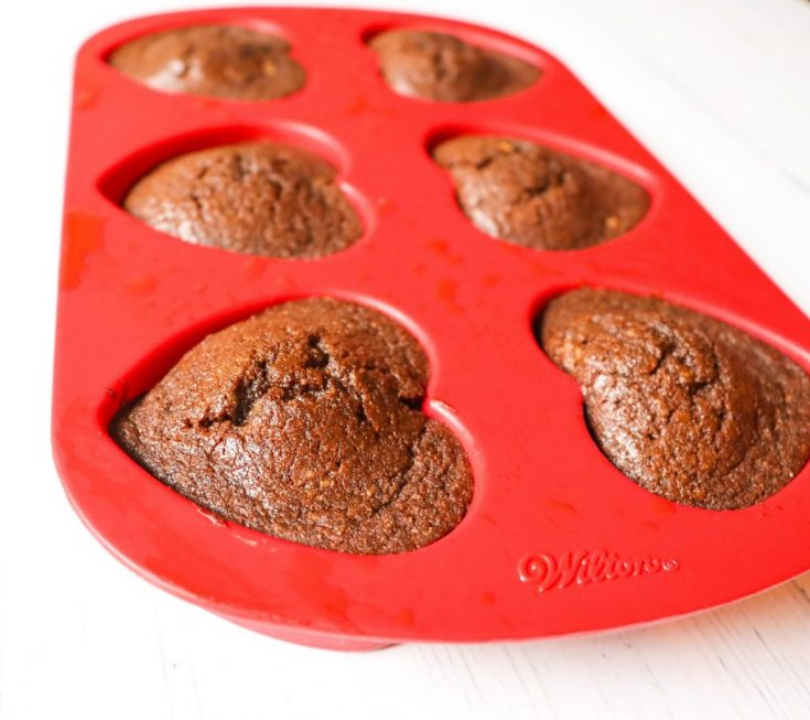 Keto Chocolate Flaxseed Muffins in red heart silicone baking pan side view