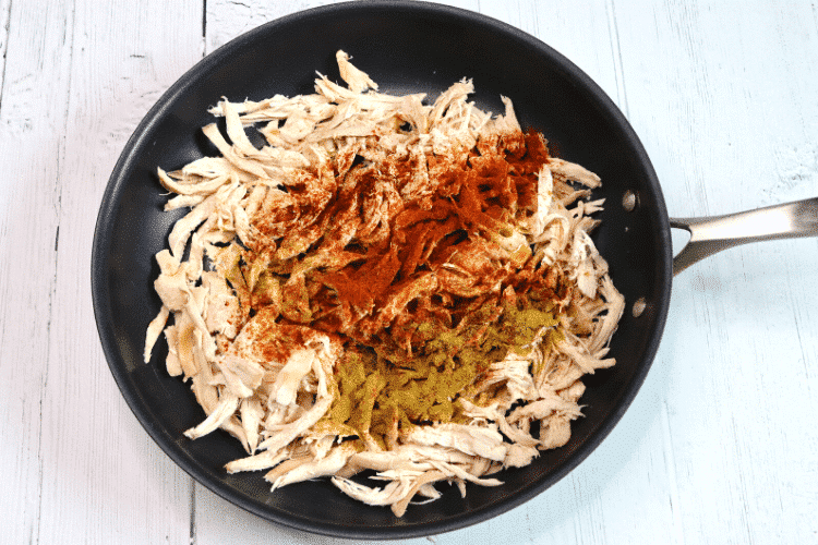 Shredded chicken with seasoning on top