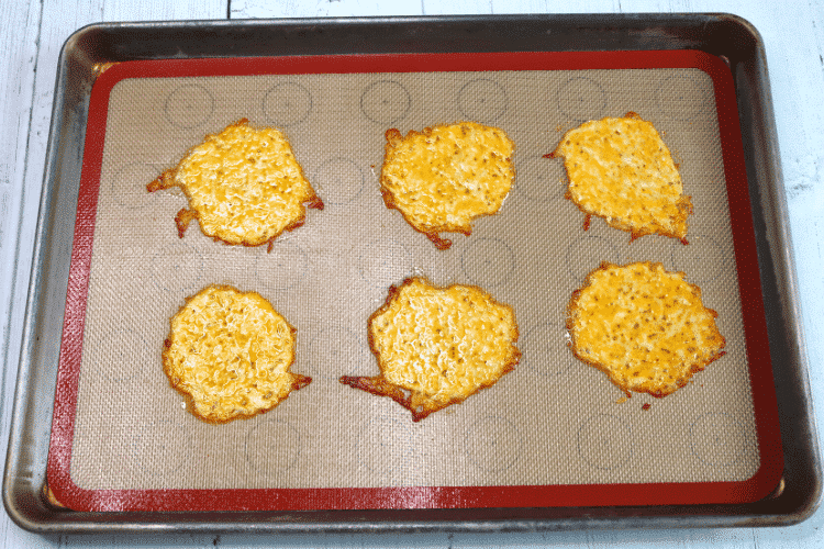 Baked cheese mounds on baking mat fresh from the oven