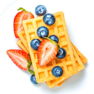 keto breakfast waffle with blueberries and strawberries